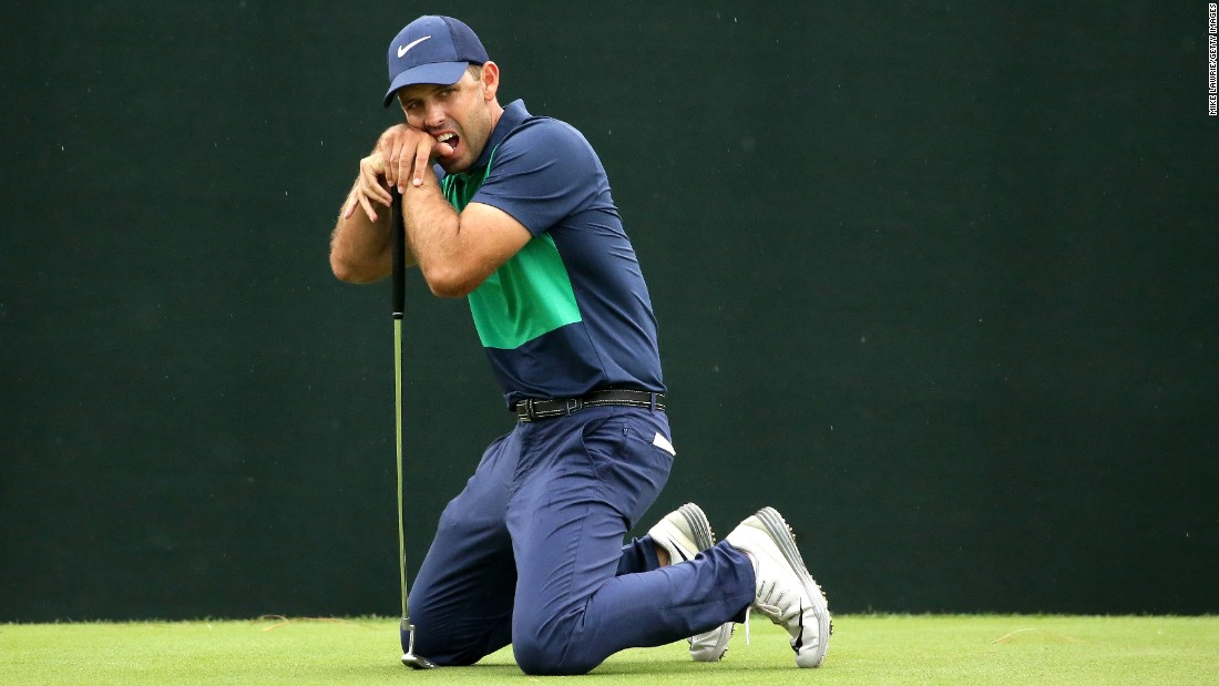 Charl Schwartzel of South Africa reacts after a putt on the 18th green during the final round of the Valspar Championship at Innisbrook Resort Copperhead Course on Sunday, March 13 in Palm Harbor, Florida.