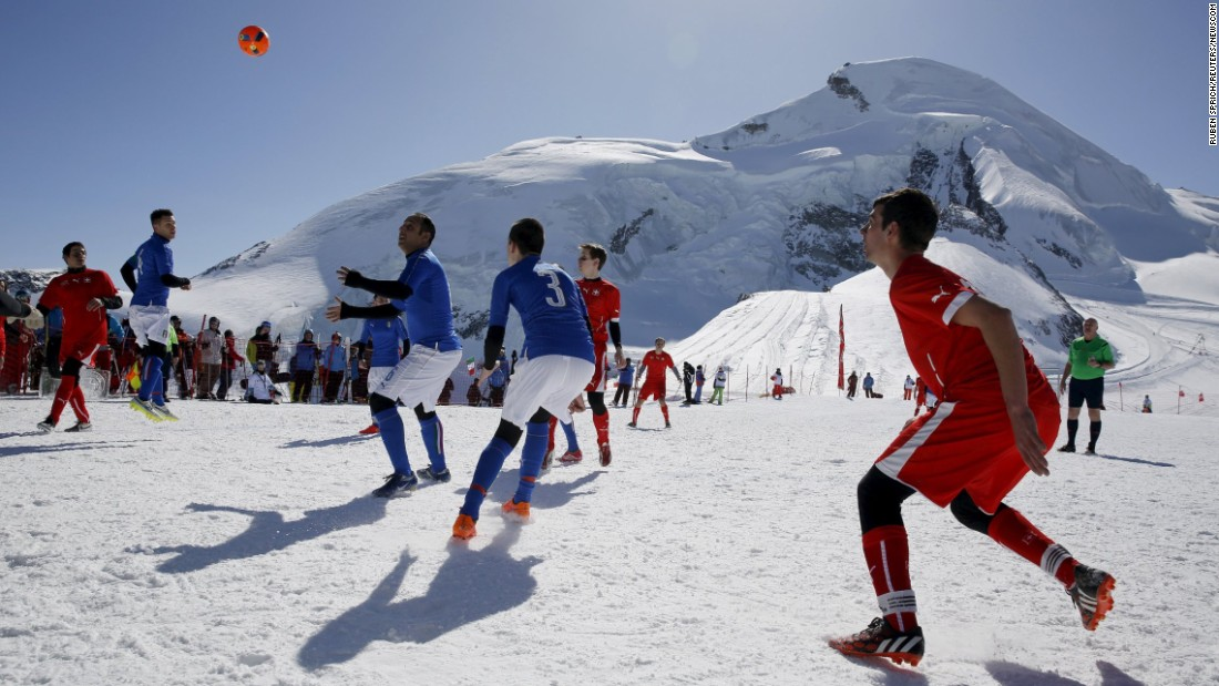 "Amateur soccer players from Switzerland play against Italy during the Euro 2016 of the Mountain Villages soccer tournament on the Allalin glacier in Saas-Fee, Switzerland, on Saturday, March 12. <a href=""http://www.cnn.com/2016/03/08/sport/gallery/what-a-shot-sports-0308/index.html"" target=""_blank"">Check out 31 sports moments from last week</a>"