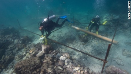 Divers excavate a wreck site off the coast of Oman