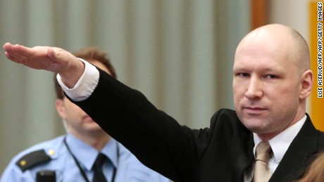 Norwegian mass killer Anders Behring Breivik makes a Nazi salute as he enters the court room in Skien prison for his lawsuit against the Norwegian state.