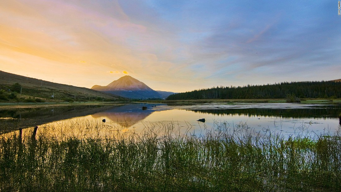 Mount Errigal is the tallest peak in Donegal, northwest Ireland. It's renowned for the pinkish glow of its quartzite rock at sunset.