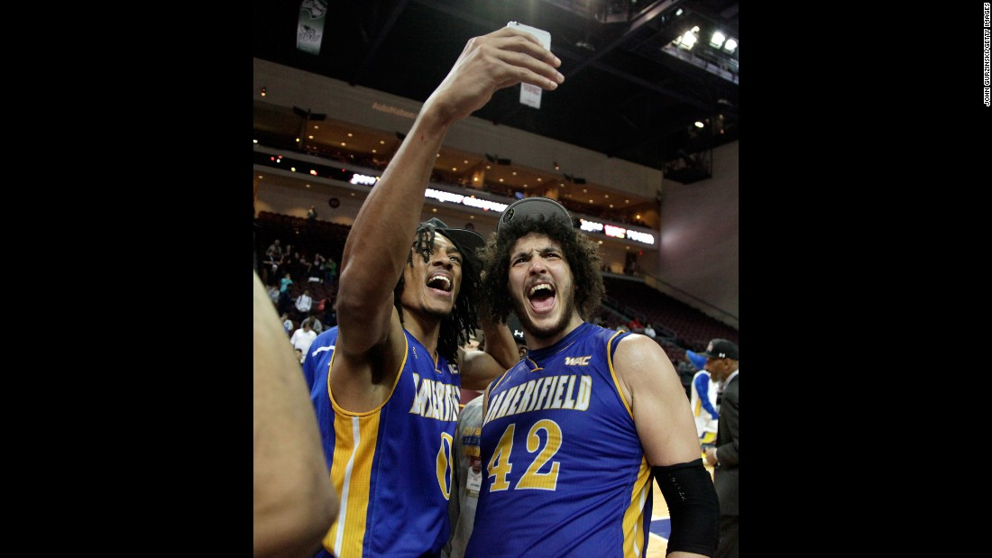 Matt Smith takes a selfie with teammate Aly Ahmed after Cal State Bakersfield won the Western Athletic Conference's basketball tournament on Saturday, March 12.