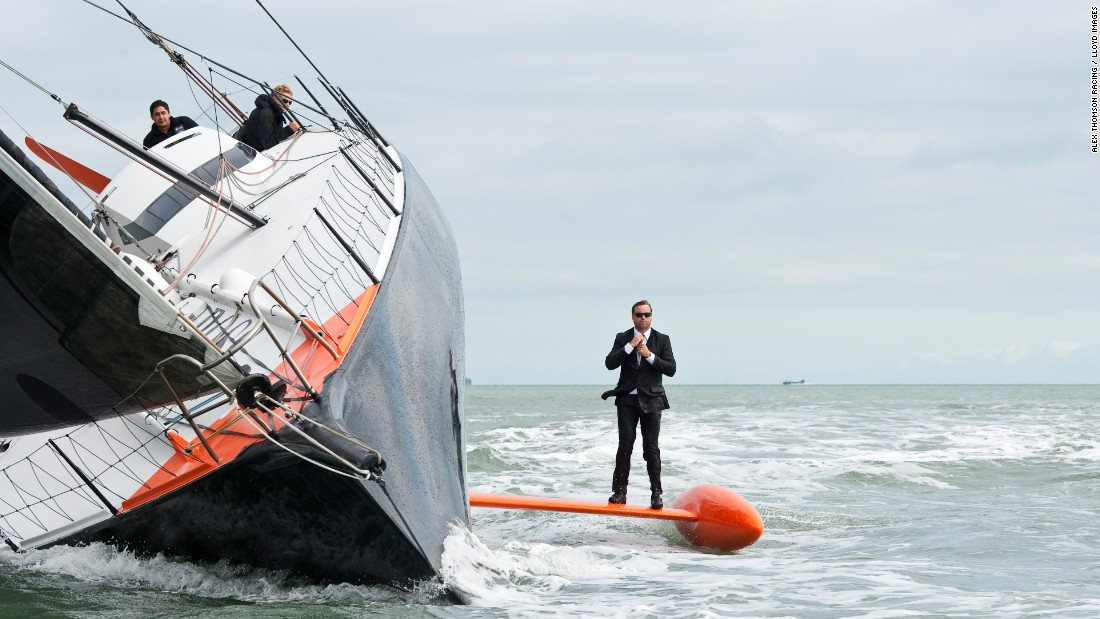 For the first stunt, Thomson strolled along the keel of his speeding race yacht.