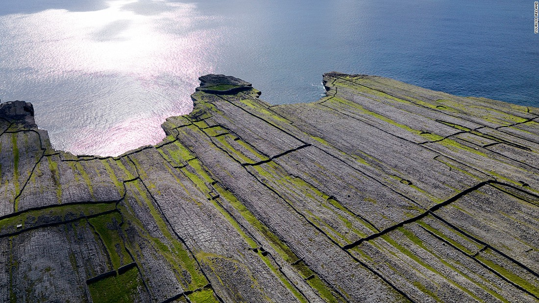 Inishmore is the largest of Galway's Aran Islands, off Ireland's west coast. The flat karst terrain is limestone crissed-crossed with cracks known as grikes.