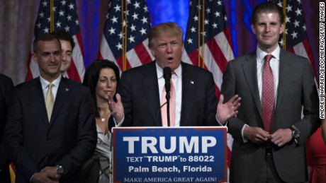 Donald Trump, president and chief executive of Trump Organization Inc. and 2016 Republican presidential candidate, center, speaks during a news conference at the Mar-A-Lago Club in Palm Beach, Florida, U.S., on Tuesday, March 15, 2016. Billionaire Trump fell short of his goal of winning the two key states he needed to clear most of the Republican presidential field, securing a huge victory in Florida to knock out Senator Marco Rubio while losing Ohio to Governor John Kasich. Photographer: Andrew Harrer/Bloomberg via Getty Images