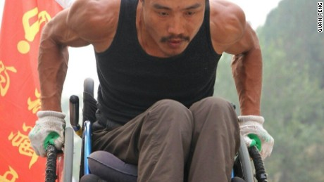 Quan has wheeled himself from Beijing to Fuzhou and has the muscles to prove it.