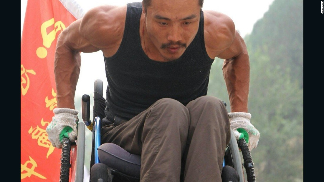 Quan Peng says he doesn't like to ask for help and has wheeled himself all the way -- as his bulging arm muscles prove.
