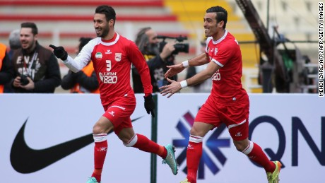 Tractorsazi's Shoja Khalilzadeh (L) celebrates with his teammate Bakhtiar Rahmani after scoring a goal during their AFC Champions League match against UAE's al-Jazira in Tabriz in February 2016.