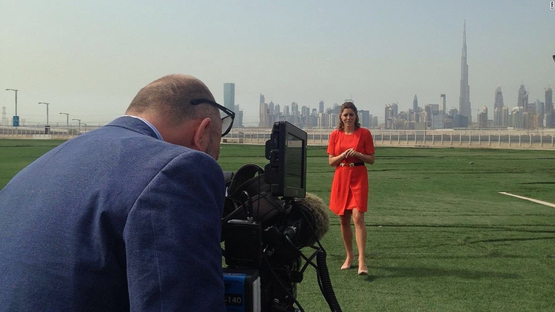 Filming links in Dubai with the city's stunning skyline as a backdrop.