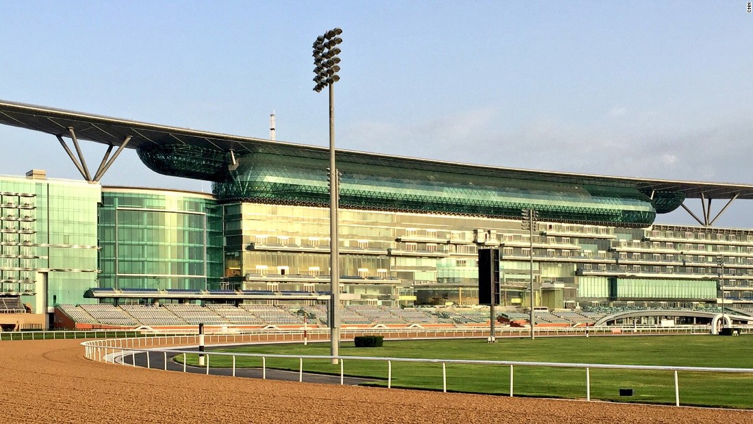 The majestic Meydan racecourse at sunrise -- the coolest time of day for the horses to work on the track.