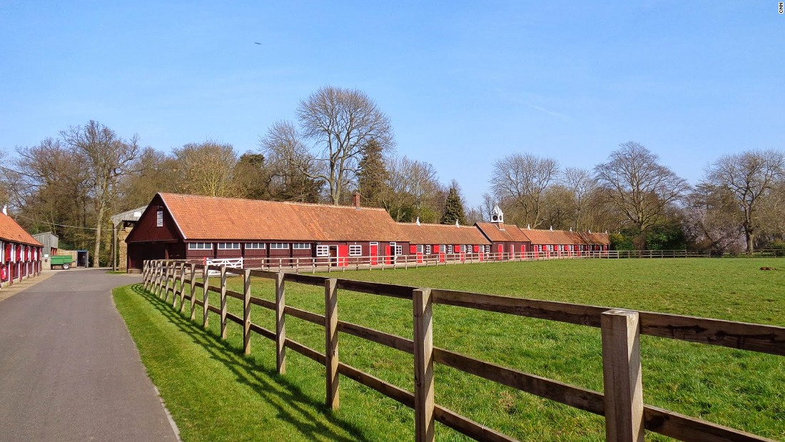 The beautiful grass paddocks and historic stable of Cheveley Park Stud, one of the oldest horse breeding centers in the world.