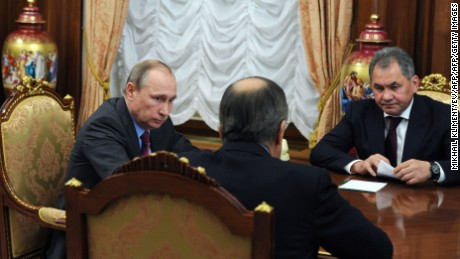 Russian President Vladimir Putin meets with Defense Minister Sergey Shoigu, right, and Foreign Minister Sergey Lavrov, center, at the Kremlin in Moscow on Monday.