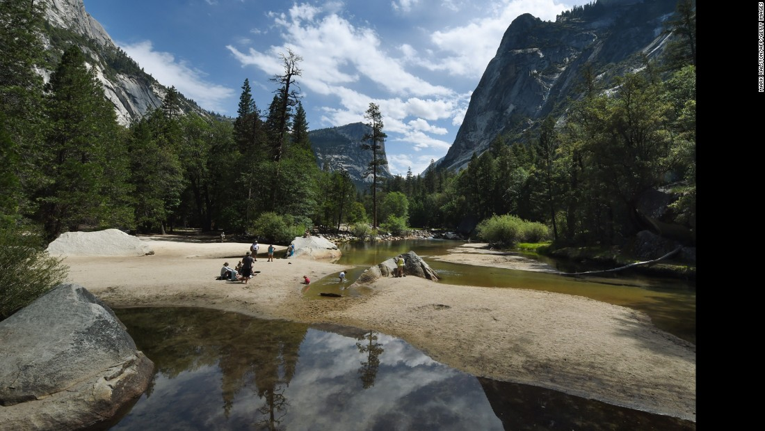 People picnic in July on the sandy bottom of Mirror Lake, which is normally covered with water at Yosemite National Park.