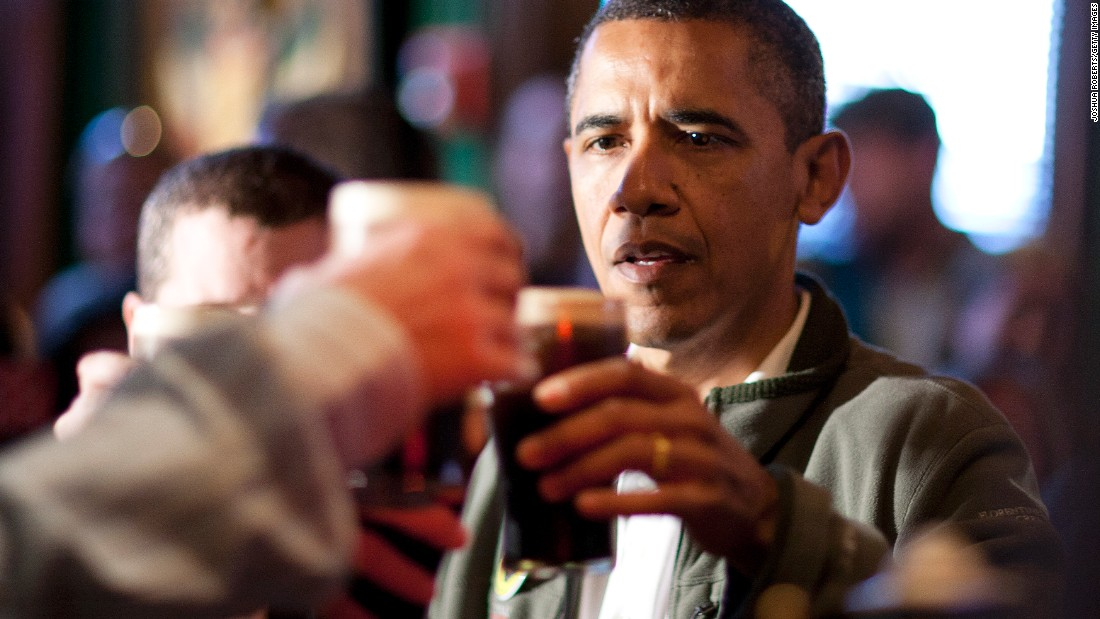 President Barack Obama toasts with Guinness beer as he celebrates St. Patrick's Day at the Dubliner Restaurant and Pub on March 17, 2012 in Washington, D.C.