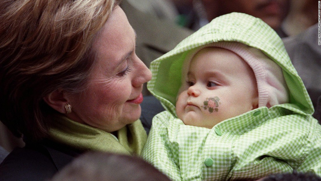 Then-first lady Hillary Clinton greets a baby as she marches in the St. Patrick's Day parade on March 17, 2000 in New York City.