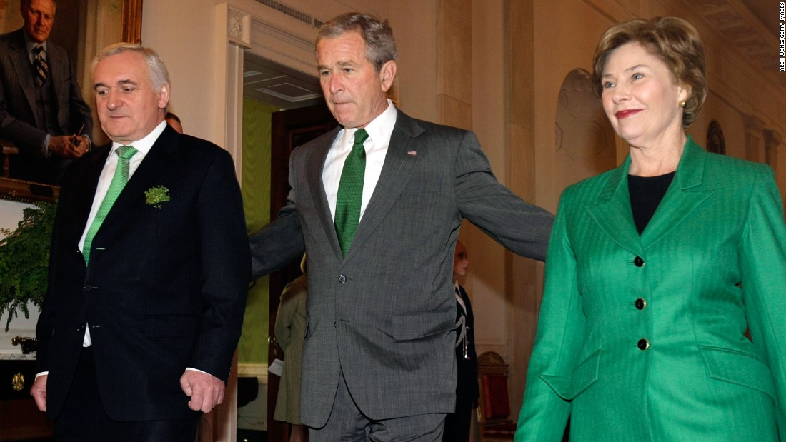 President George W. Bush walks with Irish Prime Minister Bertie Ahern and then-first lady Laura Bush at the White House for a St. Patrick's Day celebration on March 17, 2008.