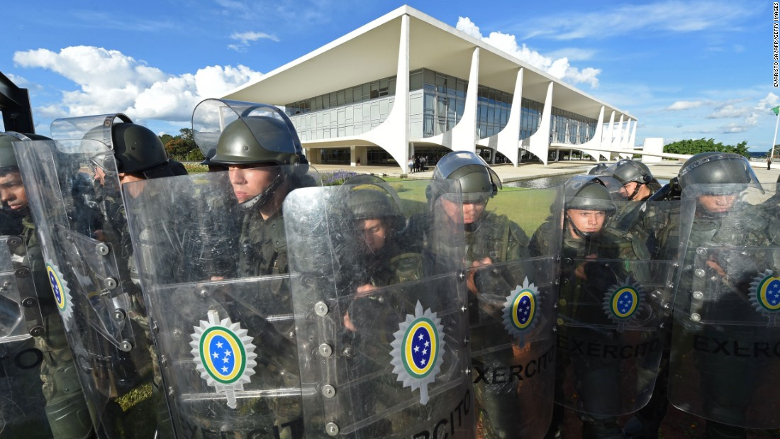 Soldiers in riot gear block the presidential palace on March 16.