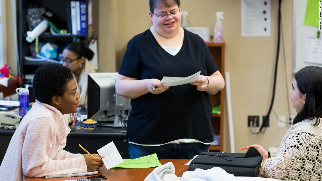 Precalculus teacher Kelley Butler talks with Marcelas and Olivia Pierce.