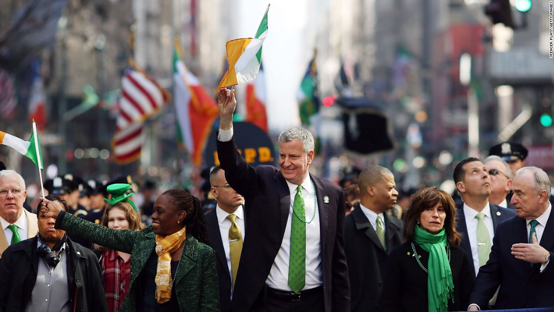 New York Mayor Bill de Blasio and his wife, Chirlane McCray, march in the city's annual parade.