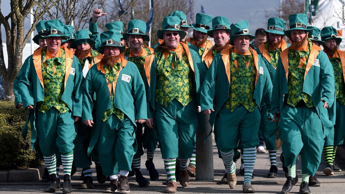 Men wear leprechaun outfits in Cheltenham.