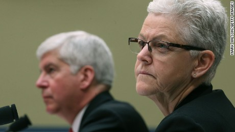 EPA Administrator Gina McCarthy, (R), and Gov. Rick Snyder, (R-MI), listen to members comments during a House Oversight and Government Reform Committee hearing, about the Flint, Michigan water crisis, on Capitol Hill March 17, 2016 in Washington, DC.