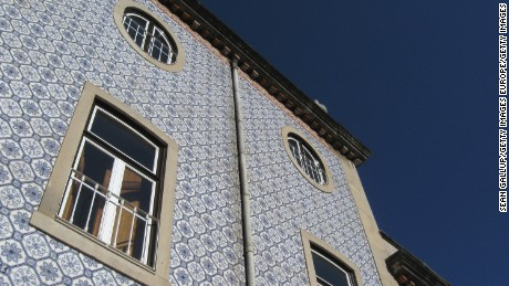 LISBON, PORTUGAL - JULY 23: A building covered in typical tiles of the region stands on July 23, 2008 in Lisbon, Portugal. Portugal is becoming an increasingly popular tourist destination.  (Photo by Sean Gallup/Getty Images)