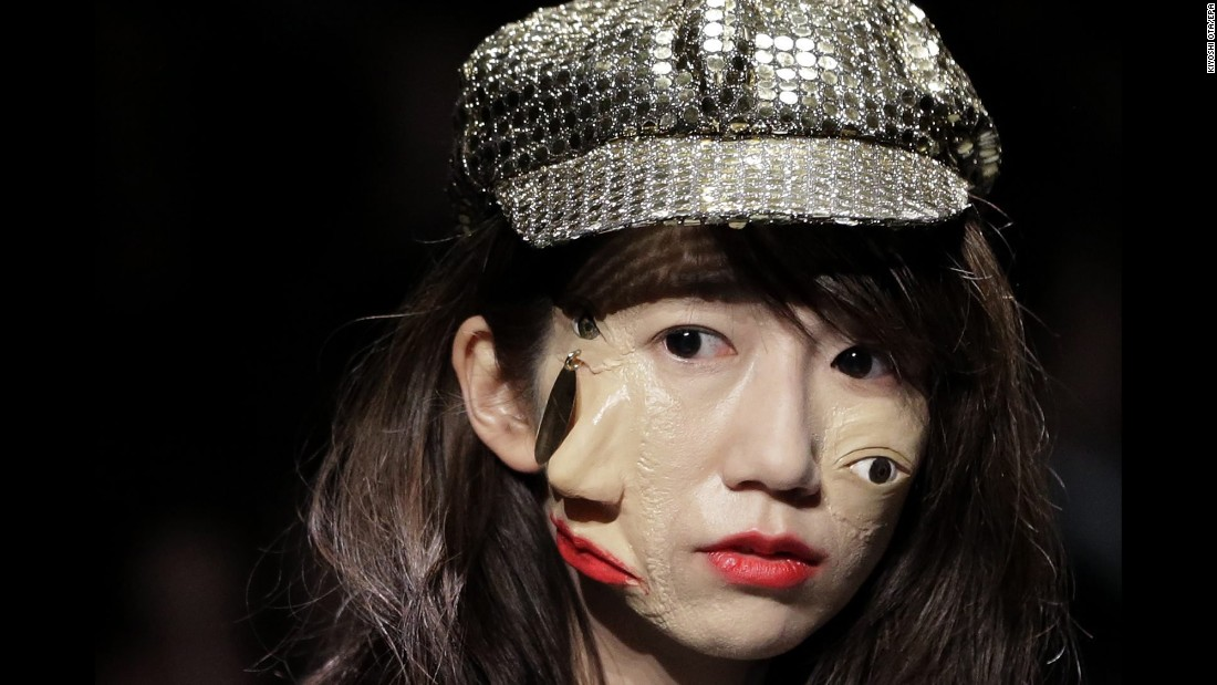 A model presents a creation by designer Yoshikazu Yamagata during Tokyo Fashion Week on Wednesday, March 16.