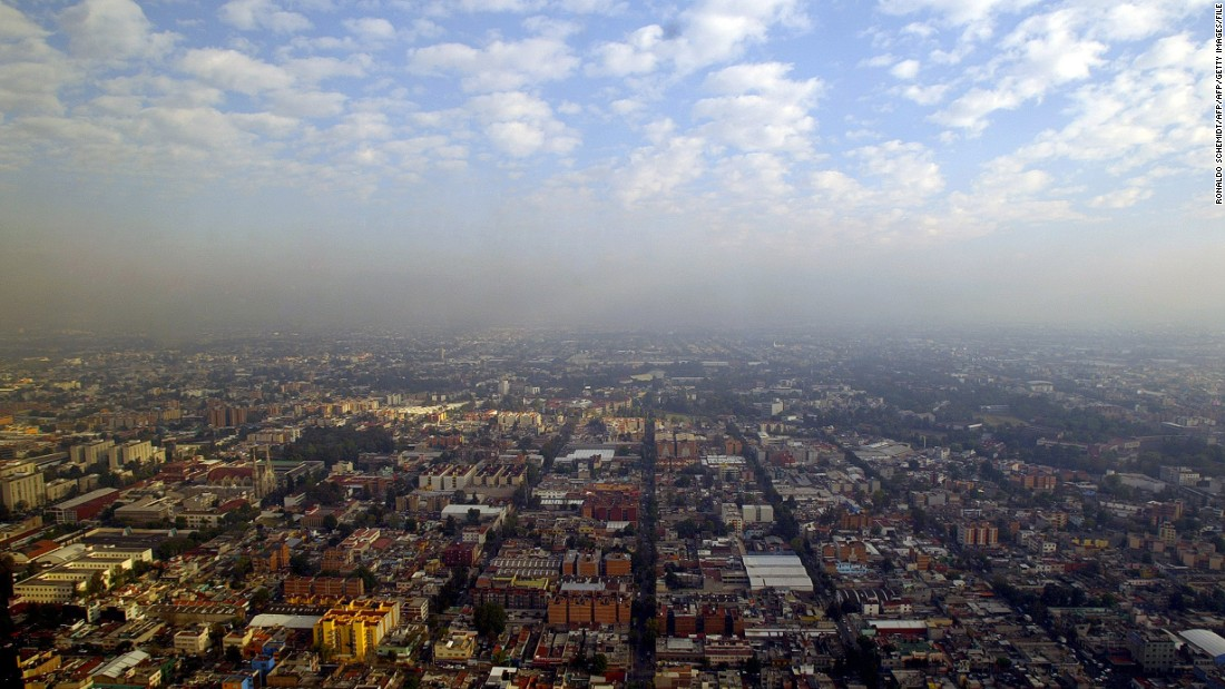 An aerial view of Mexico City taken in 2007. It's morning, but already a layer of smog hovers over the metropolis.