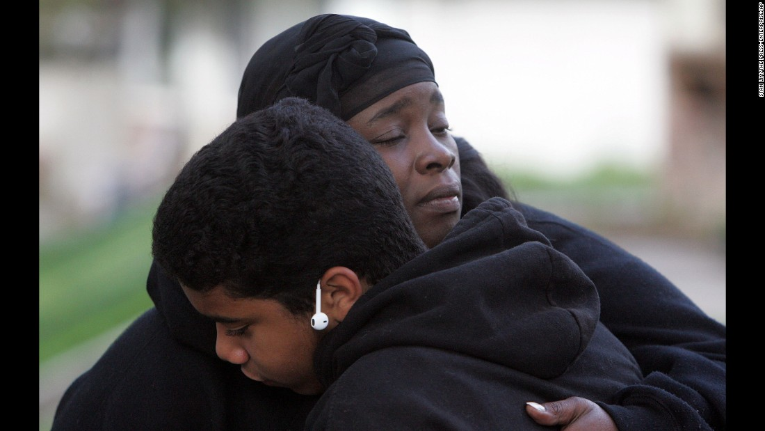 "Kevin Estrada consoles Shaunte Spears, whose son and nephew were shot in <a href=""http://www.sbsun.com/general-news/20160314/this-violence-needs-to-end-san-bernardino-candlelight-vigil-for-jason-spears-12-shot-to-death-in-drive-by"" target=""_blank"">a drive-by shooting</a> in San Bernardino, California, on Sunday, March 13. Spears' 14-year-old son, Terrance, was injured. Her 12-year-old nephew Jason was killed."