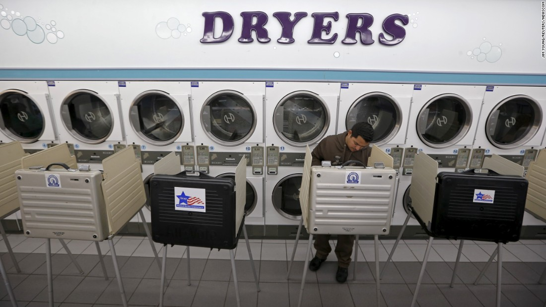 A voter casts a ballot inside a Chicago laundromat on Tuesday, March 15.