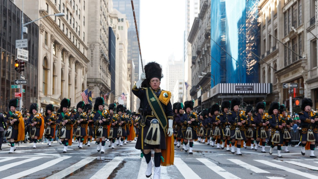 Participants perform as they march up the Fifth Avenue during the 255th St. Patrick's Day Parade in New York.
