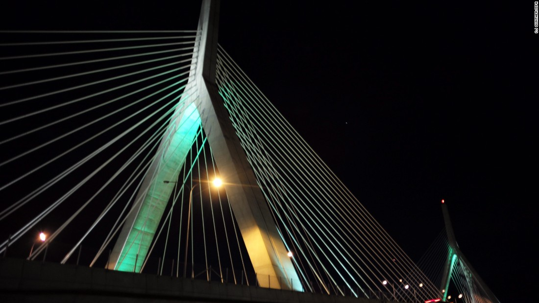 The Leonard P. Zakim Bunker Hill Memorial Bridge is lit green in honor of St Patrick's Day in Boston on Thursday, March 17.