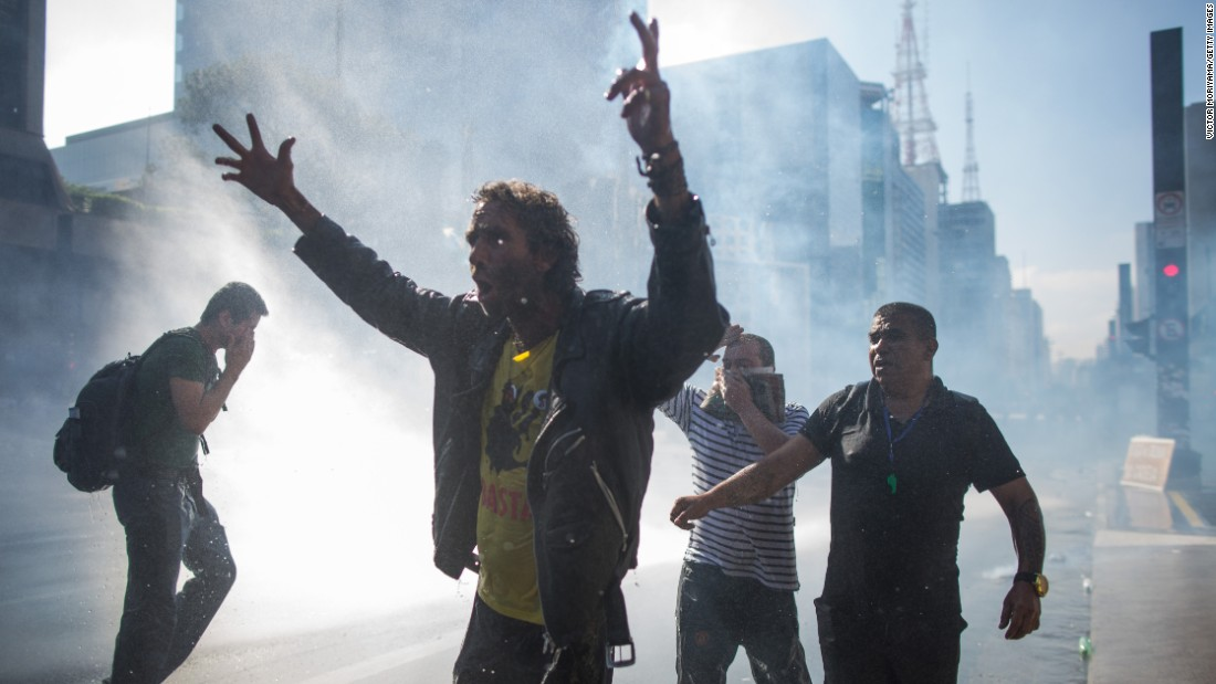 """Police use water cannons on Sao Paulo protesters on March 18. Many Brazilians are also frustrated <a href=""""http://money.cnn.com/2016/03/17/news/economy/brazil-rousseff-lula-economy/"""" target=""""_blank"""">with a spiraling economy.</a>"""