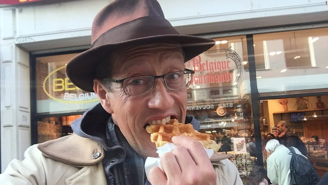 Richard Quest asked social media users to set him challenges using the hashtag #flywithquest. Tasked with eating local food, he tucks into a waffle in Brussels.