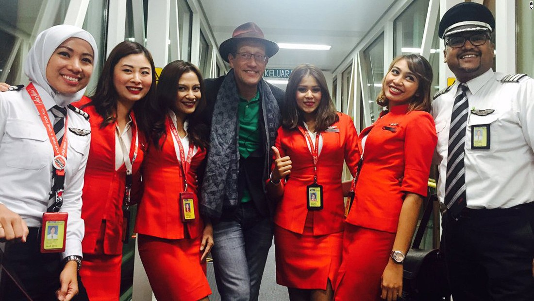 Quest poses with the AirAsia flight crew after flying from Sri Lanka to Malaysia.