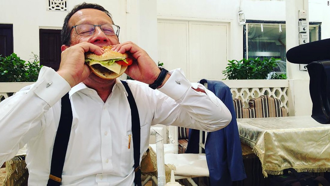 Another local food challenge: In Dubai, Quest sinks his teeth into a camel burger.