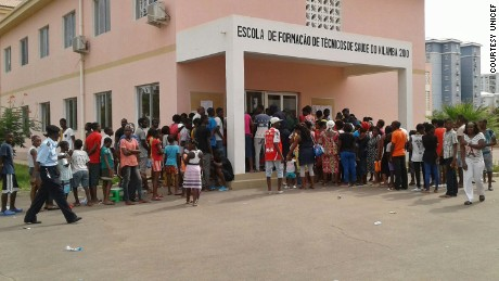 People gather for shots at a vaccination post during the campaign against yellow fever in the Kilamba neighborhood in Luanda, Angola.