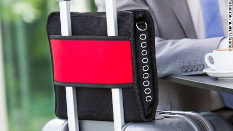 The Airpocket comes with a wide band that can be secured to a suitcase.