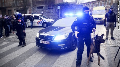 Policemen block a road, near the scene of a police raid in the Molenbeek-Saint-Jean district in Brussels, on March 18, 2016, as part of the investigation into the Paris November attacks. The main suspect in the jihadist attacks on Paris in November, Salah Abdeslam, was arrested in a raid in Brussels on March 18, French police sources said. / AFP / BELGA / DIRK WAEM / Belgium OUT        (Photo credit should read DIRK WAEM/AFP/Getty Images)