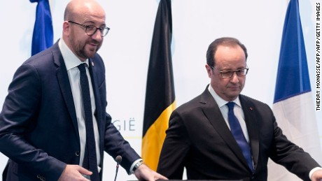 """Belgium's Prime Minister Charles Michel (L) and French President Francois Hollande arrive to give a joint press conference on 18 March 2016 in Brussels regarding a police action in Molenbeek-Saint-Jean in Brussels.  Police arrested three people including key Paris attacks suspect Salah Abdeslam in a raid in Brussels on Friday, Belgian Prime Minister Charles Michel said. Hollande said Abdeslam had been arrested """"with two accomplices and had been formally identified,"""" adding that he expected his extradition """"as quickly as possible"""".  AFP PHOTO / THIERRY MONASSE / AFP / THIERRY MONASSE        (Photo credit should read THIERRY MONASSE/AFP/Getty Images)"""