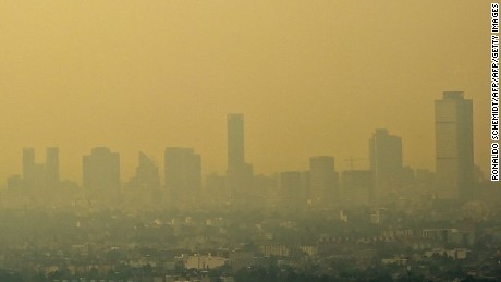 View from Tlanepantla of Mexico City blanketed by smog on March 18, 2016. Mexican officials lifted a four-day air pollution alert in the nation's densely-populated capital after ozone levels dropped, according to them, to acceptable levels. Mexico City authorities issued the first air pollution alert in 14 years due to high ozone levels, restricting traffic, encouraging children to stay indoors and ordering factories to cut emissions. AFP PHOTO / RONALDO SCHEMIDT / AFP / RONALDO SCHEMIDT        (Photo credit should read RONALDO SCHEMIDT/AFP/Getty Images)