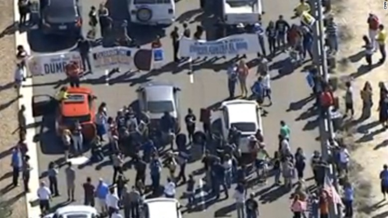 Protesters block road outside Donald Trump event