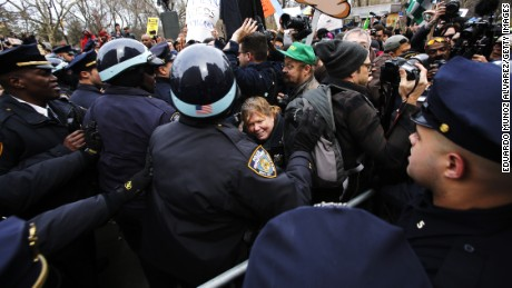 Protesters clash with NYPD officers while they take part in a protest against Republican presidential candidate Donald Trump on March 19, 2016 in New York City.