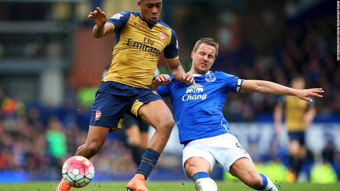 Arsenal's Nigerian 19-year-old winger Alex Iwobi (left) made his first-team debut with a stunning goal against Everton. Here he battles defender Phil Jagielka during the Premier League match at Goodison Park.