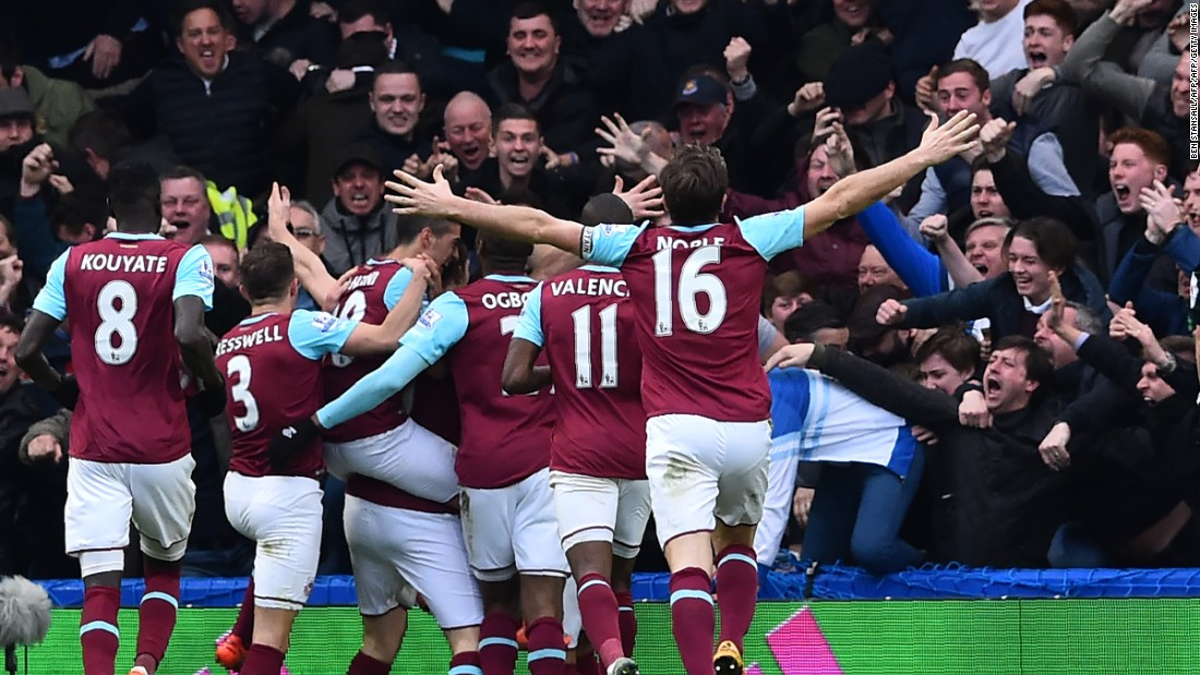 West Ham United players celebrate a goal with away supporters during the English Premier League football match on Saturday at Stamford Bridge. West Ham are battling to finish in the top four for the first time since the establishment of the Premier League in 1992.