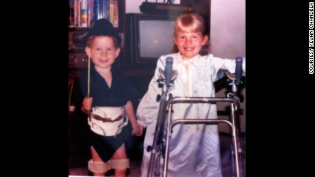 A young Kevan poses with his sister, Connie, who was also born with muscular dystrophy.