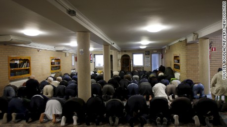 Members of Molenbeek's Muslim community attend Friday prayers at Attadamoun Mosque.