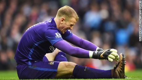 Manchester City and England goalkeeper Joe Hart winces in pain after injuring his calf and being stretchered off at the Etihad Stadium.