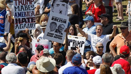Protesters filter into the crowd of Trump supporters during a campaign rally at Fountain Park on March 19, 2016 in Fountain Hills, Arizona.