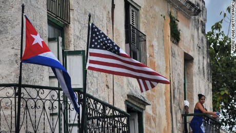 Cuban and US flags are seen on balconies in Havana on March 20, 2016. On Sunday, Obama became the first US president in 88 years to visit Cuba, touching down in Havana for a landmark trip aimed at ending decades of Cold War animosity.   AFP PHOTO/YAMIL LAGE / AFP / YAMIL LAGE        (Photo credit should read YAMIL LAGE/AFP/Getty Images)